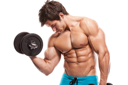 Muscular guy curling dumbbell