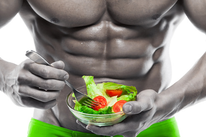 bodybuilder eating salad