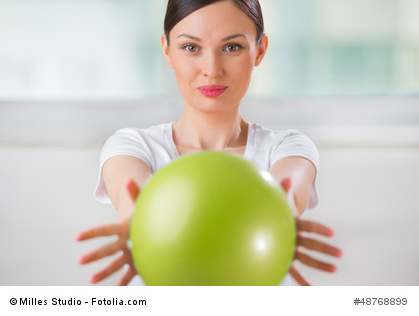 Woman using ball to do the Svend Press