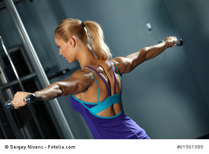 Woman performing db lateral raise