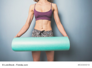 Foam roller being held by woman