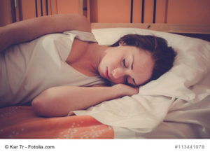 sleeping woman on bed